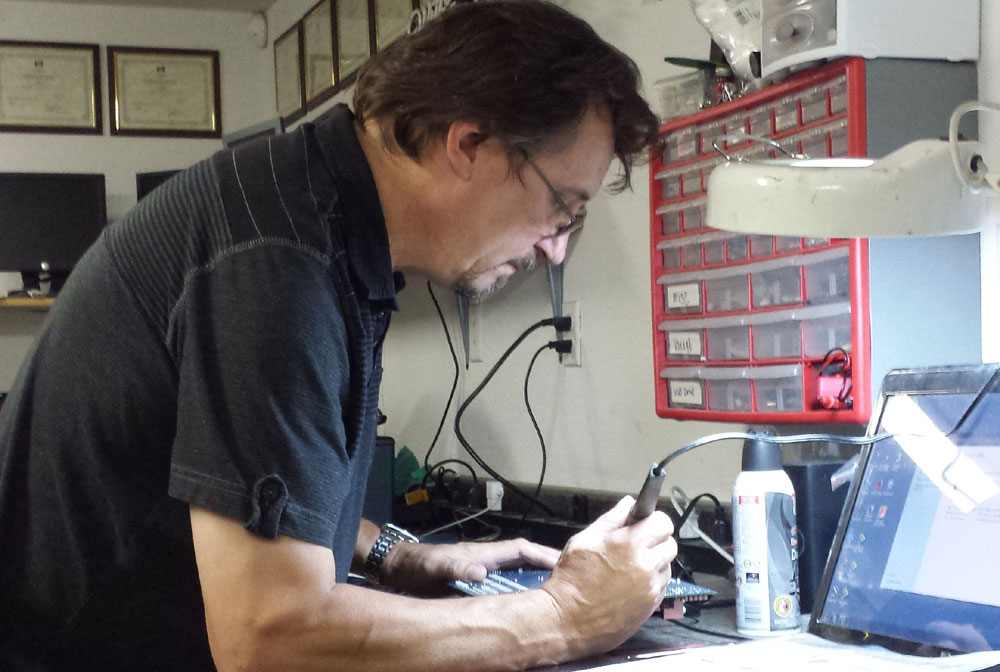 Bits 'N Bytes Computer and Printer Repair in Lodi, California - Russell Smith working on a computer